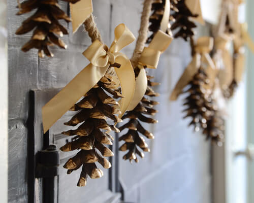 Make Your Own Garland With Pine Cones and Ribbon